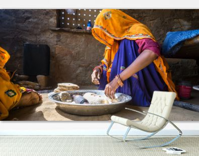 Woman Preparing Flatbread In Kitchen At Home