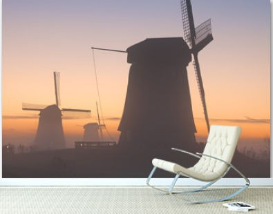 Traditional Dutch windmills in winter at sunrise