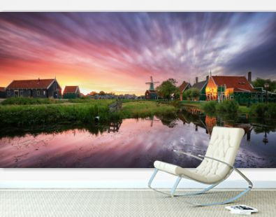 Dutch landscape with windmill at dramatic sunset, Zaandam, Amsterdam, Netherlands