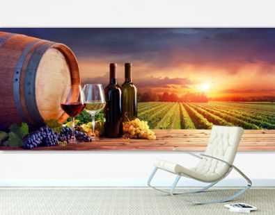 Bottles And Wineglasses With Grapes And Barrel In Rural Scene