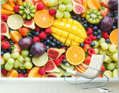 Assortment of healthy raw fruits and berries platter background, strawberries raspberries oranges plums apples kiwis grapes blueberries, mango, top view, selective focus