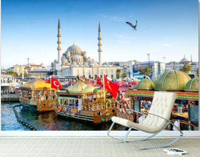 ISTANBUL, TURKEY - October 6, 2015: View of the Suleymaniye Mosque and fishing boats in Eminonu, Istanbul, Turkey