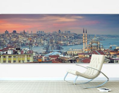 Istanbul Panorama. Panoramic image of Istanbul with Yeni Cami Mosque and Galata Bridge during sunset.