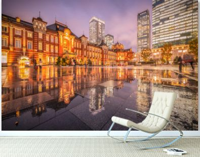 Tokyo station with reflection in raining day