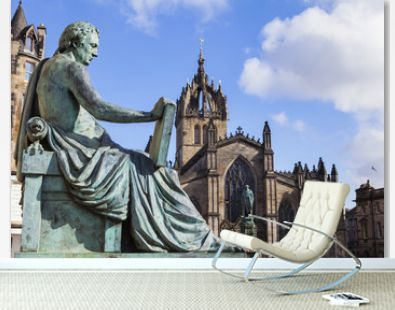 David Hume Statue and St Giles Cathedral in Edinburgh, Scotland.