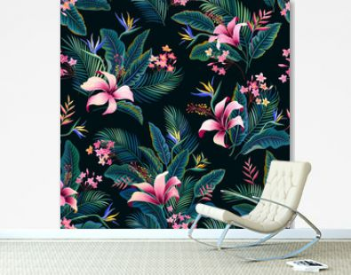 seamless floral pattern. tropical floral pattern with hibiscus and palm tree leaves on dark blue