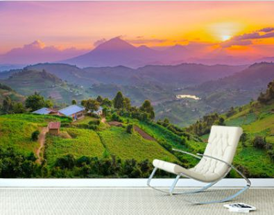 Kisoro Uganda beautiful sunset over mountains and hills of pastures and farms in villages of Uganda. Amazing colorful sky and incredible landscape to travel and admire the beauty of nature in Africa