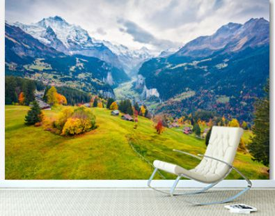 View from flying drone of Wengen village, district of Lauterbrunnen. Gloomy morning scene of Swiss Alps. Dramatic autumn landscape of Switzerland countryside, Europe. Traveling concept background.