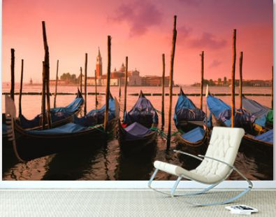 Venice with famous gondolas at gentle pink sunrise light,