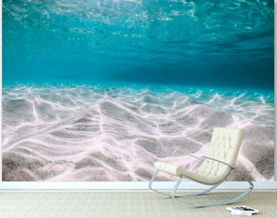Tropical blue ocean with white sand underwater in Hawaii