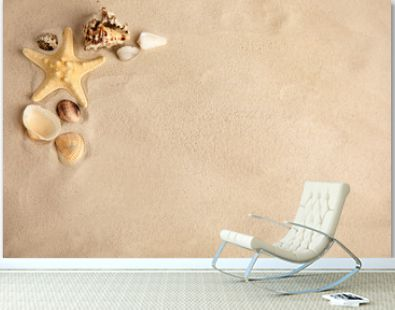 Flat lay composition with beautiful starfish and sea shells on sand, space for text