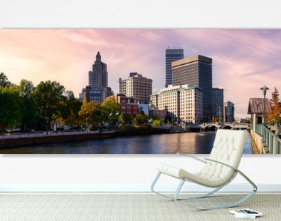 Providence, Rhode Island, United States. Panoramic view of a modern downtown city skyline on the Atlantic Ocean East Coast. Colorful Sunset Sky Art Render.