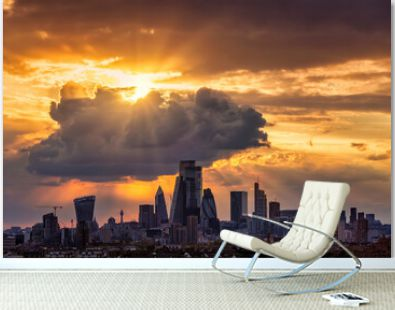 Dramatic sunset sky with clouds and sunrays over the urban skyline of the City of London, United Kingdom
