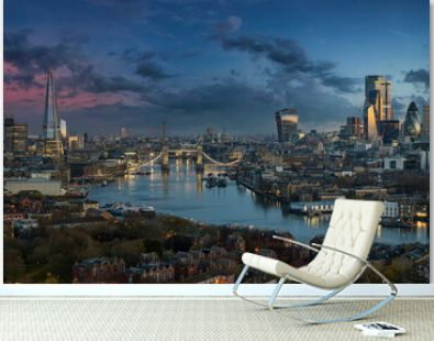 The urban skyline of London along the Thames river with Tower Bridge and Skyscrapers of the City during dawn, United Kingdom