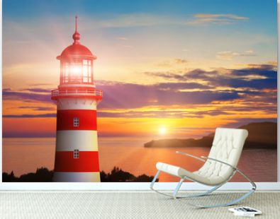 Lighthouse light and sunset at the sea coast