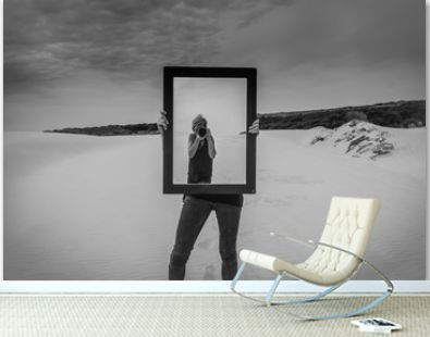 Photographer in the mirror,woman photographer in the mirror taking self portrait,one other girl holding the mirror,black and white abstract concept