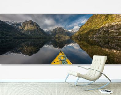 Panoramic view of Doubtful Sound, New Zealand, seen over the tip of a canoe in the foreground