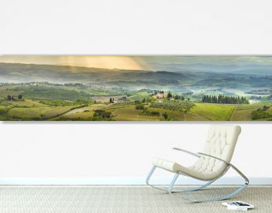 panorama with sun lights in valley in Tuscany in Italy