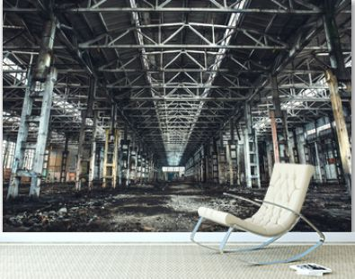 Large empty abandoned warehouse building or factory workshop