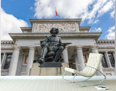 The main entrance to the Prado Museum and the bronze statue of Diego Velazquez in Madrid