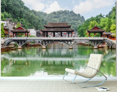 Scenic bridge reflected in water of the Tuojiang River, China