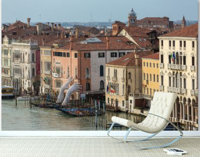 Giant hands rise from the water of Grand Canal to support the building in Venice. This powerful report on climate change from the artist Lorenzo Quinn. Venice landmarks.