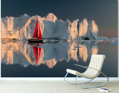 Greenland midnight Sunset iceberg perfect reflection panorama with red sail ship