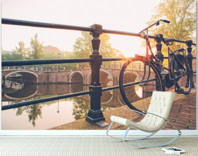 Bicycle parked by Amsterdam canal