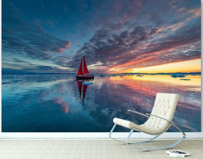Greenland midnight Sunrise mirror panorama with red sail ship