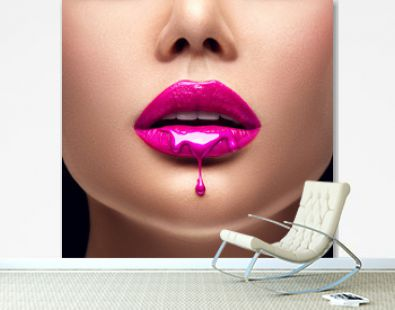 Pink lipstick dripping. Lipgloss dripping from sexy lips, Purple liquid drops on beautiful model girl's mouth, creative abstract makeup