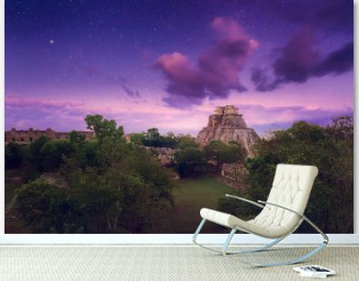 Night starry sky over the ancient Mayan city of Uxmal in Mexico.
