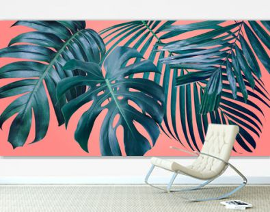Summer tropical leaves on coral color background