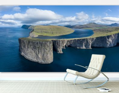 Leitisvatn lake and Tralanipan-slave rock, near Bosdalafossur waterfall on Vagar, Faroe Islands