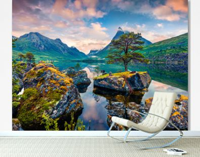 Great summer sunrise on the Innerdalsvatna lake. Colorful morning scene in Norway, Europe. Beauty of nature concept background. Beauty of nature concept background.