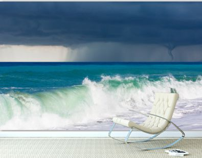 Storm on the sea with tornado