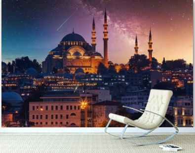 View to Eminonu pier and Suleymaniye mosque across Bay of Golden Horn on starry night
