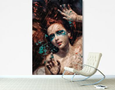 Surreal portrait of red haired girl like a mermaid behind the glass with under water effects.