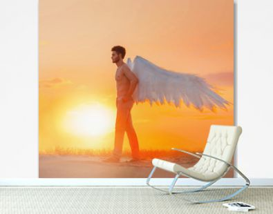 Artwork Mysterious dark silhouette. Handsome young man. creative costume of angel with white wings. Background fantasy sand desert dramatic orange sky sunset bright sun. Sexy athletic naked torso body