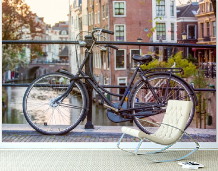 Bicycle in the center of Utrecht in the Netherlands with canals in the background