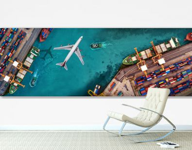 Aerial view and top view cargo plane flying above ship port in the export and import business and logistics international goods. Shipping cargo to harbor by crane