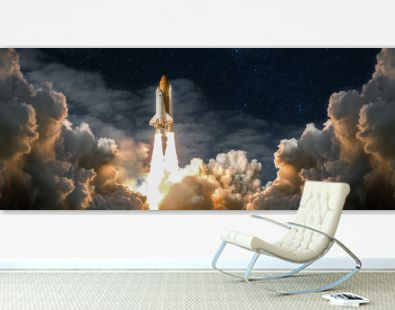 Spaceship takes off into the night sky on a mission. Rocket starts into space concept.Elements of this image furnished by NASA