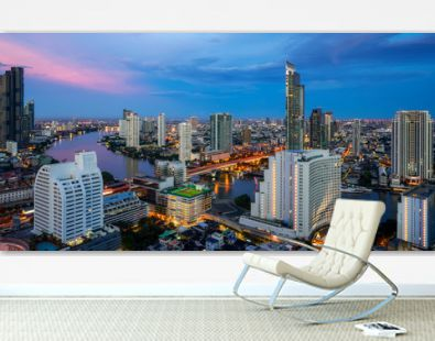 Cityscape in Bangkok city from roof top bar in hotel with Chao phraya river background