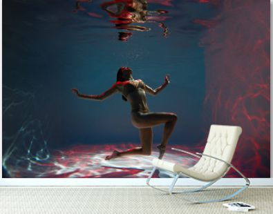 A woman with nice body dancing under water.Underwater photo