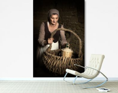 Rembrandt portrait of a woman checking food basket