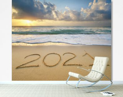 2021 year on the sea shore during sunset
