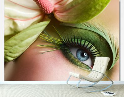 Green eye make-up with flower