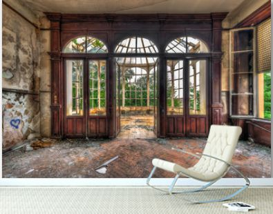 Abandoned room with view through beautiful broken conservatory