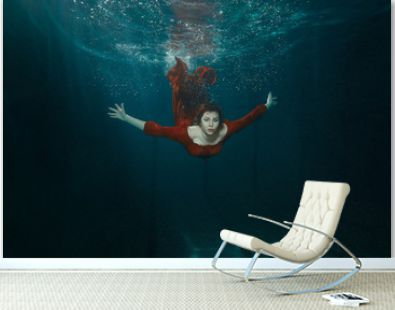 Woman in a dress dives.