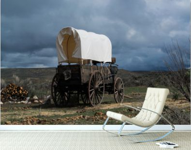 Western covered chuckwagon for cooking food on the trail drive with storm aproaching