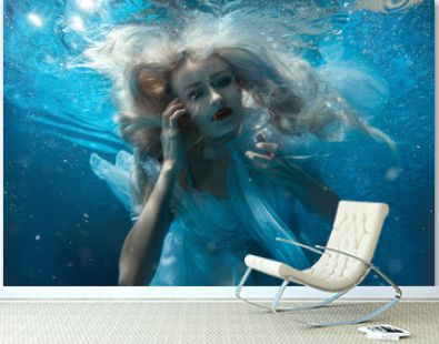 Portrait of a woman under water.